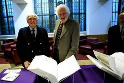 Drs. Hast and Garrison with the two volumes of the new Fabrica