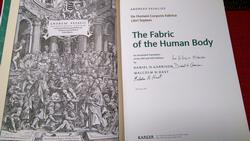 Title pages of the new Fabrica with the authors' signatures