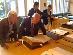 Professor Vivian Nutton and Professor Omer Steeno looking at a first edition of the Fabrica